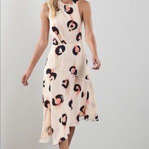 Asymmetric luxurious chiffon dress.